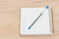Buts pour 2016 - liste de contrôle sur le bloc-notes avec le stylo Photo libre de droits