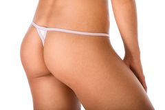 Butt of woman wearing thong without cellulite Royalty Free Stock Image