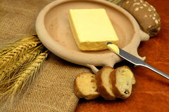 Butter. On ceramic plate with knife royalty free stock image