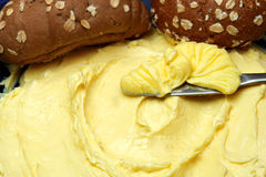 Butter. Yellow butter close-up detail & knife royalty free stock images