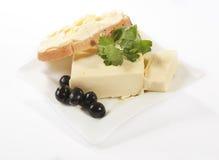 Butter auf einer Platte mit Brot Lizenzfreies Stockbild