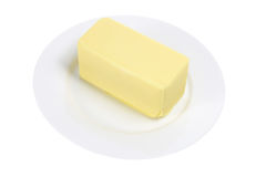 Butter auf Platte Stockfotografie