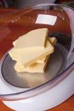 Butter auf Skala Stockbild