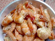 Butter baked prawns. In a pan  on red and white sheet Stock Image