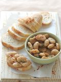 Butter beans with rosemary & garlic and a baguette stock photos