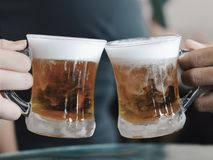 Butter Beer Cheers. Harry Potter`s famous butterbeer being cheered Royalty Free Stock Photography