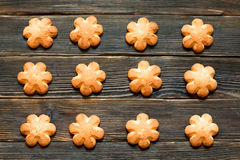 Butter biscuits brown color in the form of a flower on a dark ba. Ckground. Top wiev. Cooking concept Royalty Free Stock Photo