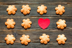 Butter biscuits brown color in the form of a flower on a dark ba. Butter biscuits brown color in the form of a flower and red heart on a dark background. Top Royalty Free Stock Photos