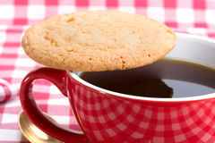 Butter biscuits and a cup of black coffee Royalty Free Stock Image
