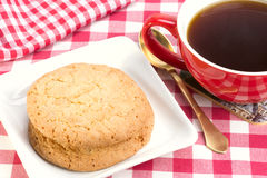 Butter biscuits and a cup of black coffee Stock Photography