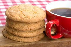 Butter biscuits and a cup of black coffee Royalty Free Stock Images