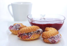 Butter biscuits with fruit jam Stock Photos