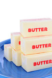 Butter on Blue Plate Royalty Free Stock Image