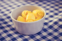 Butter in bowl at breakfast table Stock Photography