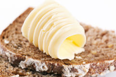 Butter on the bread. Piece of bread with fresh butter Royalty Free Stock Photo