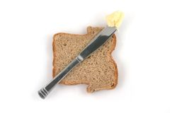 Butter and bread Stock Image