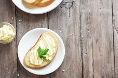 Butter and bread. For breakfast on rustic wooden background with copy space. Morning breakfast, butter and toasts stock photos