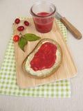 Butter bread with cornelian cherry jam for breakfast Stock Images