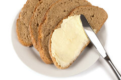 Butter on bread Stock Photos