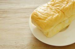 Butter bread loaf on plate royalty free stock images