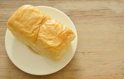 Butter bread loaf on white dish Stock Photography