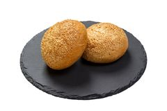Butter bread roll on a plate on white background stock photos