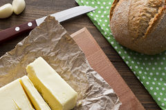 Butter and bread. Butter with bread top view lie on a wooden table Stock Photography