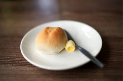 Butter with bread on white plate : closeup royalty free stock image
