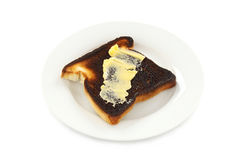 Butter On Burnt Toast Royalty Free Stock Photos