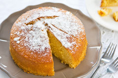 Butter cake. With orange zest and juice by coffee royalty free stock images