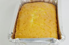 Butter cake in aluminium tray Stock Images