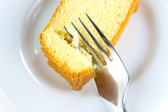 Butter cake with a fork Stock Photos