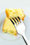 Butter cake with a fork Royalty Free Stock Images
