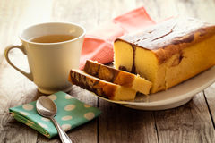 Butter cake with props surrounded. On wood background Royalty Free Stock Photography