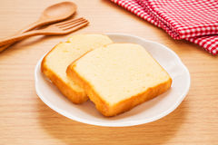 Butter cake sliced on plate Royalty Free Stock Image