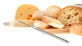 Butter, cheese, bread and a knife. Piece of butter, cheese, bread and a knife Royalty Free Stock Photography