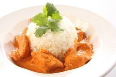 Butter chicken. Indian butter chicken on rice Royalty Free Stock Images