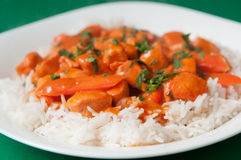Butter chicken. Indian butter chicken sauce with rice and sliced carrots Royalty Free Stock Photography