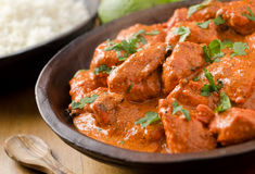 Butter Chicken Curry. A bowl of creamy butter chicken curry with basmati rice and lime Royalty Free Stock Photo