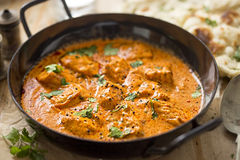 Butter chicken. Curry with coriander and naan bread Royalty Free Stock Images