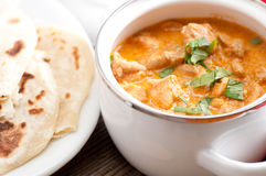 Butter chicken and naan Royalty Free Stock Image