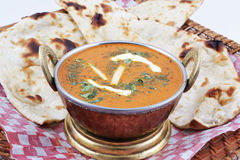 Butter chicken with naan royalty free stock photography