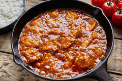 Butter chicken traditional Indian spicy curry meat food with rice Stock Photography
