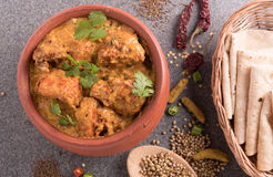 Butter chicken on wooden background Stock Photos