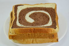 Butter chocolate swirl bread on dish Royalty Free Stock Photos