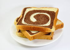 Butter chocolate swirl bread on dish Royalty Free Stock Photography