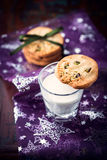 Butter cookie with pistachios on a glass of milk Royalty Free Stock Photos
