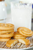 Butter cookies. Closeup of fresh butter cookies on a plate with glass of milk in the background Stock Images