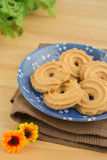 Butter cookies on blue plate Royalty Free Stock Photos