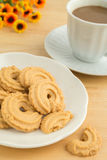 Butter cookies and coffee cup Stock Image